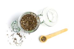 Chia seed grains  on white. Background jar spoon top seeds healthy food raw nutrition glass brown pile vegan heap organic ingredient omega view protein dry diet stock image