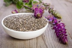Chia seed healthy superfood in bowl with flower on wooden tabl Royalty Free Stock Photo