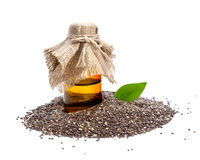 Chia seed with pharmaceutical bottle. Isolated on white background royalty free stock photography