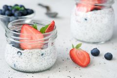 Chia seed pudding with fresh blueberries and strawberries on white table. Closeup view. Dieting, detox, healthy lifestyle and weight loss concept Stock Photography