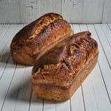 Chia seed sourdough sandwich bread. On a wooden table board royalty free stock photos