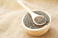 Chia seed on wood bowl. Chia seeds on wood bowl Royalty Free Stock Photos
