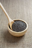 Chia seed in a wooden cup against burlap background.  stock image