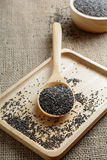 Chia seed on a wooden spoon. Against burlap background stock photos
