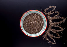 Chia seeds in beautiful plate. On black background Royalty Free Stock Image