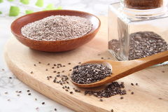 Chia seeds. Black and white Chia seeds on wood board Royalty Free Stock Image