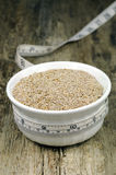 Chia seeds in bowl with measuring tape Royalty Free Stock Photography