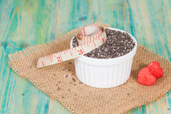 Chia seeds in bowl with measuring tape. Stock Photo