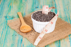 Chia seeds in bowl with measuring tape. Stock Images