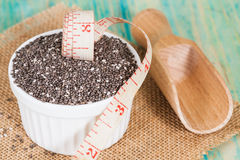 Chia seeds in bowl with measuring tape. Royalty Free Stock Photos