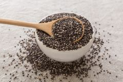 Chia seeds in bowl. With wooden spoon Royalty Free Stock Photography