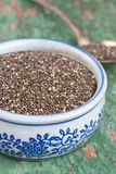 Chia seeds in a bowl on wooden surface Royalty Free Stock Photos
