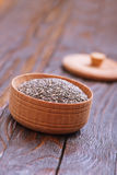 Chia seeds. In bowls and on a table Stock Photos