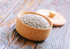 Chia seeds. In bowls and on a table Stock Images