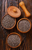 Chia seeds. In bowls and on a table Stock Image