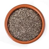 Chia seeds in a ceramic bowl isolated on white background. Closeup. Top view. Chia Super Food. Healthy eating concept.  royalty free stock photos