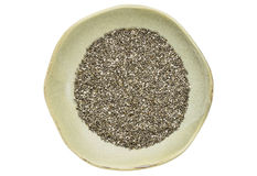 Chia seeds in ceramic bowl Stock Image