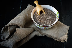 Chia seeds in ceramic bowl Stock Image