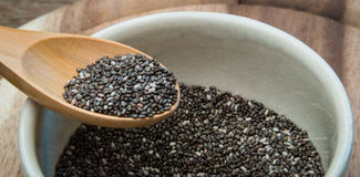 Chia seeds. Closeup wooden spoon on Chia seed bowl Stock Images
