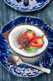 Chia seeds coconut pudding with berries. top view Stock Photos