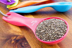 Chia seeds. In colourful spoon on a wooden background Royalty Free Stock Image