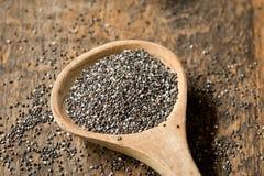 Chia Seeds in cucchiaio di legno Fotografie Stock Libere da Diritti