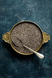 Chia seeds on dark baclground directly above Stock Image