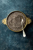 Chia seeds on dark baclground directly above Royalty Free Stock Image