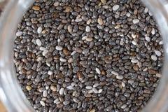 Chia Seeds in de glasfles Royalty-vrije Stock Afbeelding