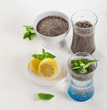 Chia seeds drink with a water, mint and lemon in glass. Stock Photo