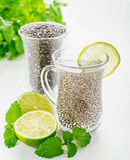 Chia seeds drink with water. In transparent glass with lime and lemon balm. selective Focus Stock Photo