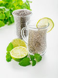 Chia seeds drink with water. In transparent glass with lime and lemon balm. selective Focus Royalty Free Stock Photo