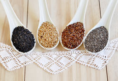 Chia seeds. Flax seeds. White sesame seeds. Sesame seeds black. Stock Photo