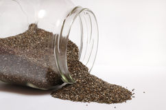 Chia seeds in a glass jar on white Royalty Free Stock Photo