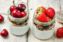 Chia seeds granola Greek yoghurt pudding with berries. Toning. selective focus Stock Photo