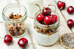 Chia seeds granola Greek yoghurt pudding with cherries Stock Image