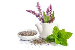 Chia seeds healthy superfood with flowers. On white background royalty free stock image