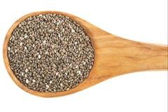 Chia Seeds i den isolerade träskeden Royaltyfria Foton