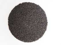 Chia seeds lie on a round white surface royalty free stock photos