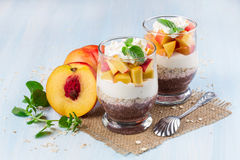 Chia seeds with oat flakes and peaches Stock Photo