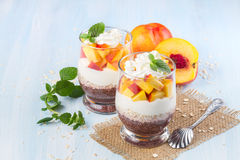 Chia seeds with oat flakes and peaches Stock Image