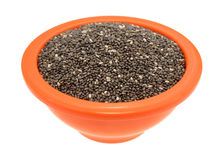 Chia seeds in an orange bowl on a white background Stock Image