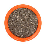 Chia seeds in an orange bowl on a white background Stock Photography