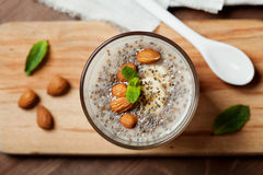 Chia seeds pudding with oat, banana and almonds decorated with mint leaves Royalty Free Stock Photography