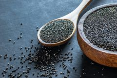 Free Chia Seeds  Salvia Hispanica  In Wooden Spoon And Bowl On Black Wooden Rustic Background Royalty Free Stock Photo - 154641915