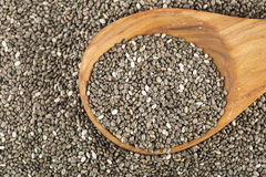 Chia Seeds with Spoon. Dark Chia seeds on wooden spoon. Heart healthy source of omega-3s stock images