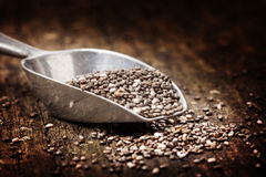 Chia seeds. On spoon on wood Stock Photo