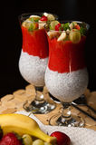 Chia seeds and strawberry mousse in wine glasses Royalty Free Stock Photos