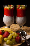 Chia seeds and strawberry mousse in wine glasses Stock Photos