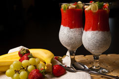 Chia seeds and strawberry mousse in wine glasses Stock Images